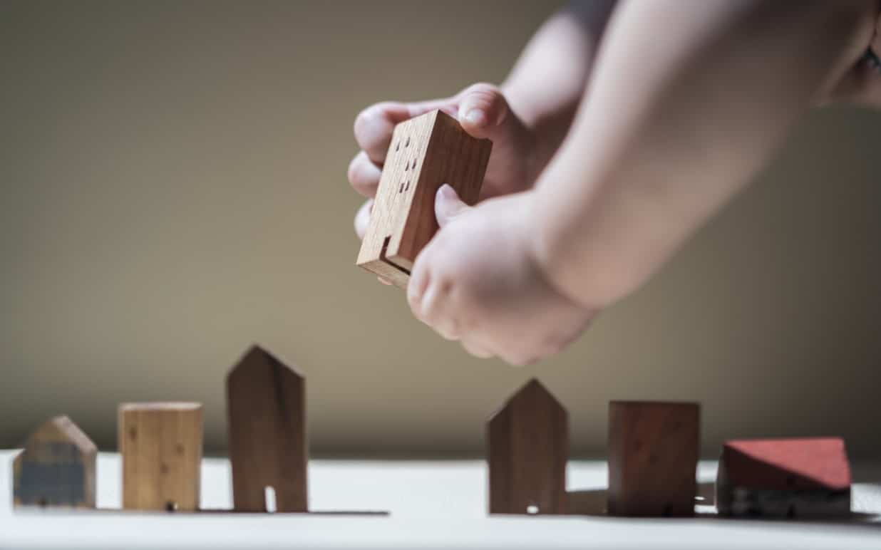 The Charitable Legacy Planning Mindset | A baby building a city with blocks